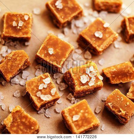 Salted caramel pieces and sea salt close up top view