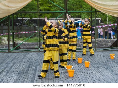 Lviv Ukraine - April 27.2014: Members of the children's dance group performing during the summer playground in the citypark Lviv Ukraine