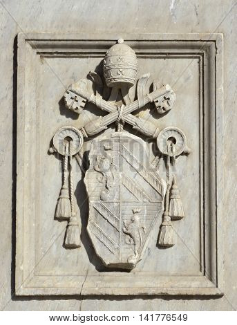Relief of Pope Pius IX emblem on a monument erected in Tiber Island (Rome) and made by sculptor Jacometti in 1869