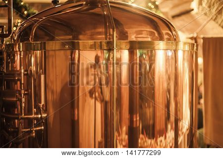 Large copper container for whisky. Whisky production.