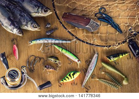 many fishing tackle on a wooden table
