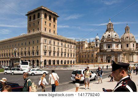 ROME, ITALY, MAY 09, 2012:  Piazza Venezia at the monument Vittorio Emanuele II, in the background the Palazzo di Venezia and the church of Santa Maria di Loreto