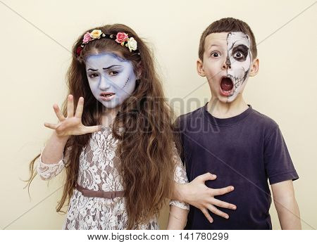 zombie apocalypse kids concept. Birthday party celebration facepaint on children dead bride, scar face,  skeleton together having fun