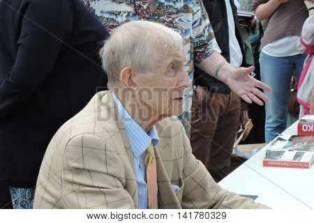 MOSCOW - JUNE 03, 2016: Famous Russian poet, writer Evgeny Evtushenko reads his poetry publicly on the Red Square in Moscow. Moscow Book Fair.