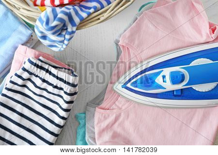 Clothes in wicker basket with iron