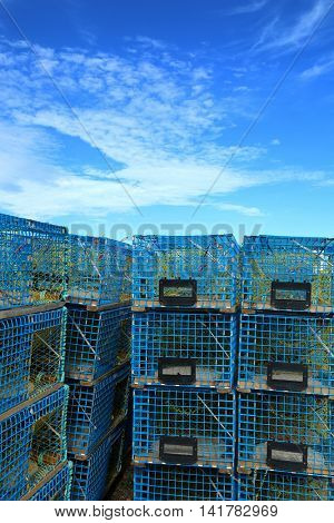Blue lobster cages in a blue sky