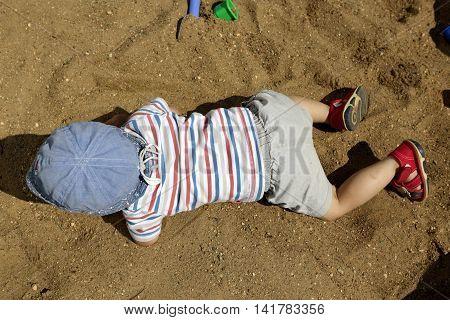 Boy Crawling In Sandbox