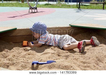 Kid Crawling In Sandbox