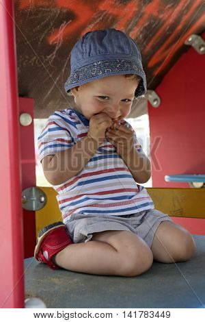 Toddler In Wooden Toy House