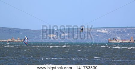 kitesurfer jumping on his board in Portland harbour