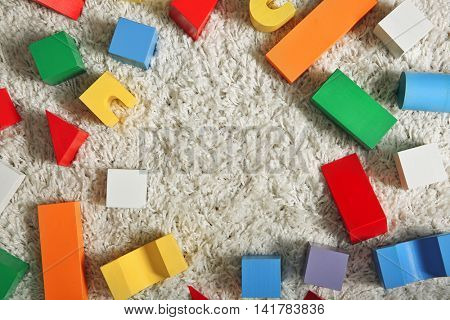 Set of wooden colorful building blocks, top view