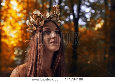 Beautiful Woman In Autumn Forest