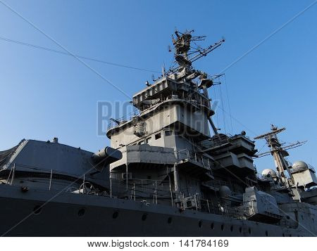 Close-up view of naval ship with guns