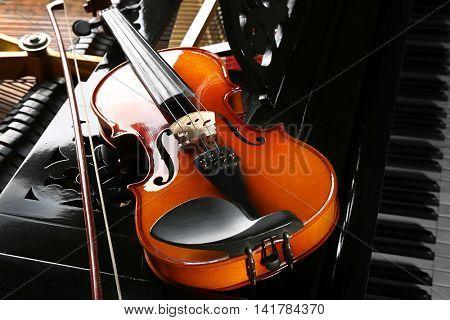 Violin on piano, closeup