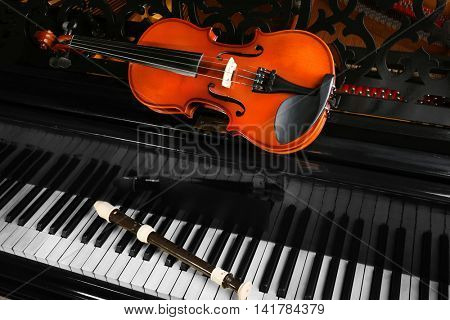 Flute and violin on piano