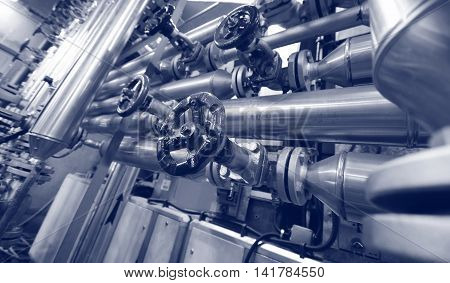 Industry oil and gas pipes concept of industry systems steel pipelines blue toned