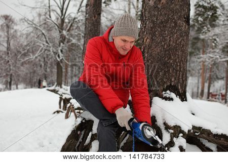 Mature man wears skates outdoors