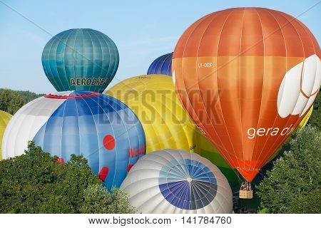 VILNIUS, LITHUANIA - MAY 05, 2015: Unidentified people start flight with the hot air balloons over Vilnius city, Lithuania.