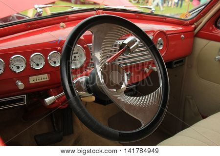 a Dashboard of a vintage sports car
