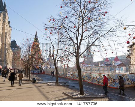 Moscow - November 29 2015: A large outdoor skating rink on Red Square Christmas ornaments and people walking in the days of winter break 29 November 2015 Moscow Russia