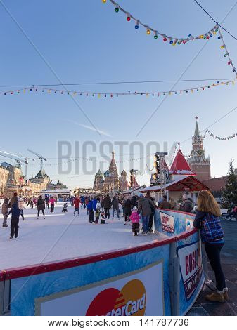 Moscow - November 29 2015: Big beautiful outdoor skating rink on Red Square Christmas ornaments and people walking in the days of winter break 29 November 2015 Moscow Russia