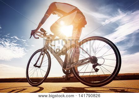 Cyclist in the sun. Race winner. Bottom view