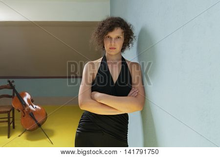 portrait of young woman with cello, interior