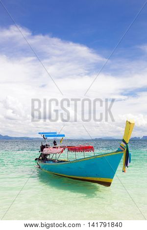 Long Tail Boat at tropical White Sand Beach Trang near Phuket Thailand