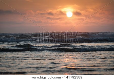 Sunset over Pacific ocean at Cape Lookout Oregon USA
