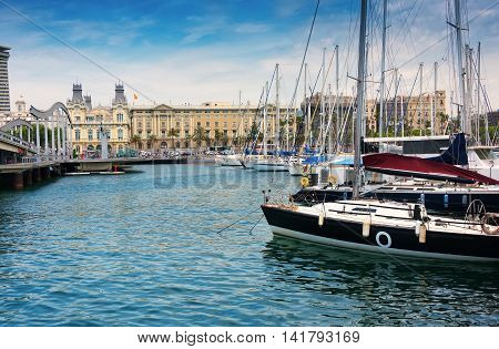 Barcelona Spain - June 6 2016: Port Vell (Old Harbor) in Barcelona Spain is a waterfront marina. It was built as part of an urban renewal program prior to the 1992 Barcelona Olympics.
