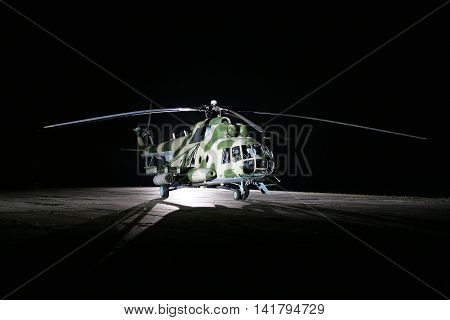 military helicopters on the tarmac at night Russian weapons