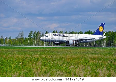 SAINT PETERSBURG RUSSIA -MAY 11 2016. D-AIUK Lufthansa Airbus A320 airplane.Lufthansa airplane rides on the runway after arrival in Pulkovo airport. Lufthansa is the largest German airline