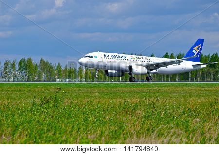 ST PETERSBURG RUSSIA - MAY 11 2016. Landing airplane. P4-KBC Air Astana Airbus A320 airplane closeup airplane view. Airplane rides on the runway after arrival at Pulkovo airport in St Petersburg Russia