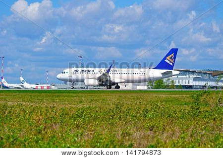 ST PETERSBURG RUSSIA - MAY 11 2016. Riding airplane. P4-KBC Air Astana Airbus A320 airplane closeup airplane view. Airplane rides on the runway after arrival at Pulkovo airport in St Petersburg Russia