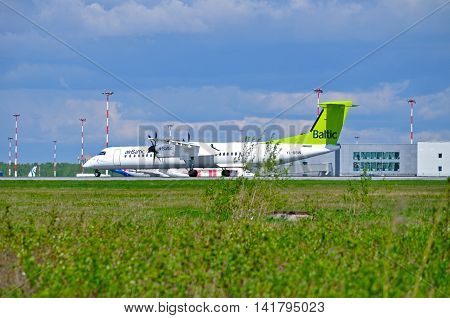 SAINT PETERSBURG RUSSIA - MAY 11 2016. YL-BBW Air Baltic Airlines Bombardier Dash 8 airplane is riding on the runway after arrival in Pulkovo airport. Air Baltic is the Latvian flag carrier airline