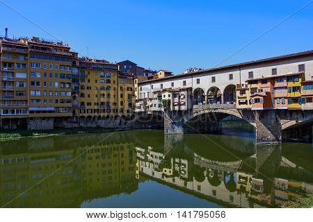 The famous bridge, the Ponte Vecchio, which goes over the Arno River, in the city of Florence