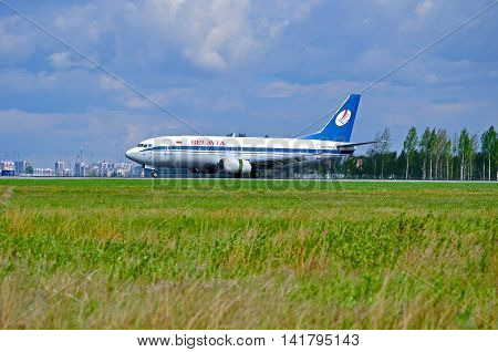 SAINT PETERSBURG RUSSIA- MAY 11 2016. EW-254PA Belavia Airlines Boeing 737 airplane is riding on the runway in Pulkovo airport. Closeup of Belavia airplane.Belavia is the national airline of Belarus