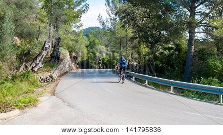 Cyclist training on the Balearic Island Majorca in Spain perfect for travel sport fitness blogs