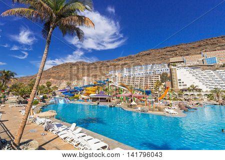 TAURITO, GRAN CANARIA, SPAIN - APRIL 20, 2016: Tourists on sun holidays at the Lago Taurito aquapark in Taurito, Gran Canaria. Taurito is very popular tourist destination