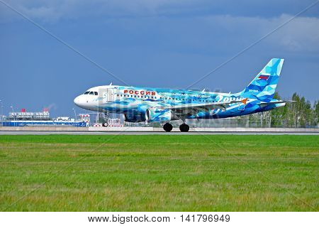 SAINT PETERSBURG RUSSIA -MAY 11 2016.VQ-BAS Rossiya Airbus A319 airplane FC Zenit livery after landing in Pulkovo airport. Rossiya airplane closeup. Rossiya Airlines is a Russian airline