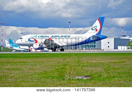 SAINT PETERSBURG RUSSIA - MAY 11 2016. VQ-BTY Ural Airlines Airbus A319 airplane after landing. Closeup of Ural Airlines airplane. Ural Airlines is an airline based in Yekaterinburg