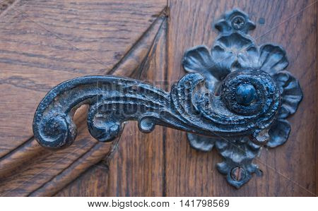 Metal dark stry door handle horizontal format