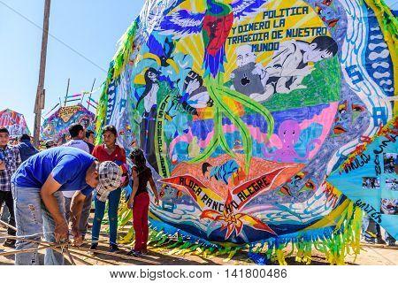 Sumpango Guatemala - November 1 2015: Local ties together bamboo framework to make handmade kite at giant kite festival on All Saints' Day honoring spirits of dead.