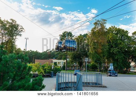 DRUSKININKAI LITHUANIA - AUG 08: The arrival of the cabins of the cable car across the river Neman to the final station at August 08 2016 in Druskininkai Lithuania