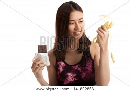 Beautiful Asian Healthy Girl With Chocolate And Measuring Tape.