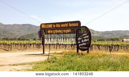 NAPA VALLEY, CALIFORNIA, APRIL 20, 2014: a view of the Napa Valley Welcome Sign, vineyards and mountains in the early afternoon
