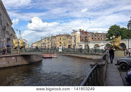 SAINT PETERSBURG, RUSSIA, JUNE 28, 2014: view of the Griffins Bridge over the Griboyedov Canal and a dramatic sky, in the late afternoon