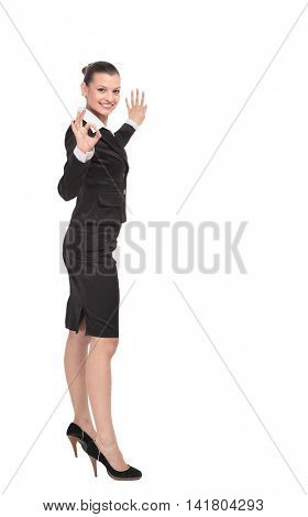 Beautiful business woman is showing okay sign with happiness.