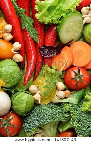 Fresh vegetables with water drops as a background