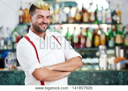 barman portrait standing near bartender desk in restaurant bar